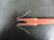 W clip inserted into tool