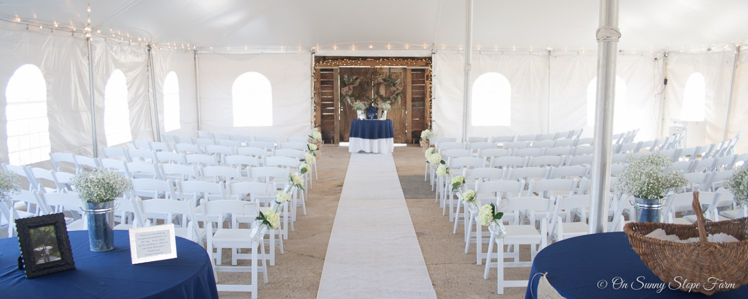 indoor ceremony setup under tent on sunny slope farm-3