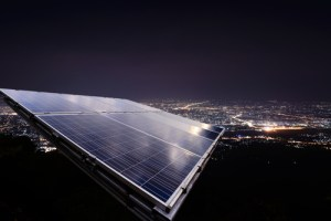 rooftop solar panels at night