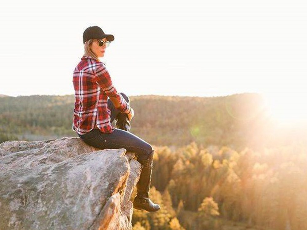 Woman sitting atop Eagle's Nest Lookout