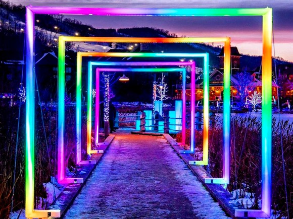 Colourful light installations decorate the trail at Blue Mountain Village
