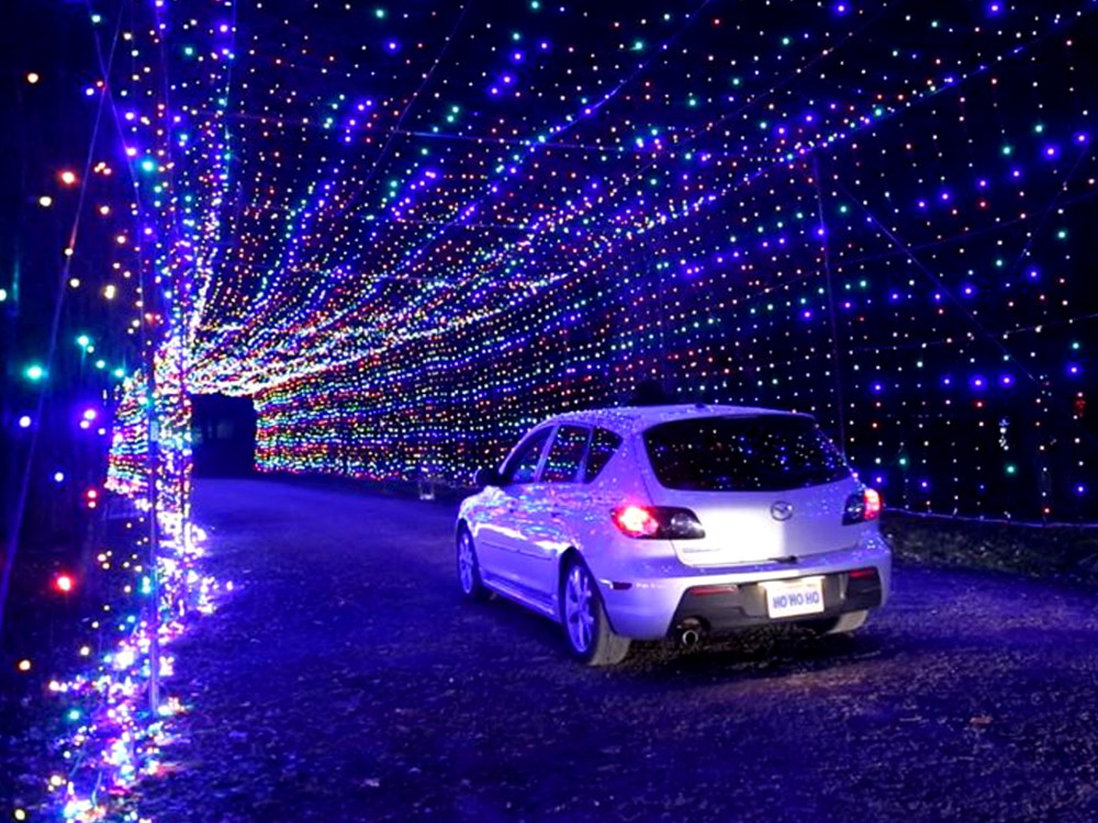 Vehicle driving through the twinkling tunnel of lights