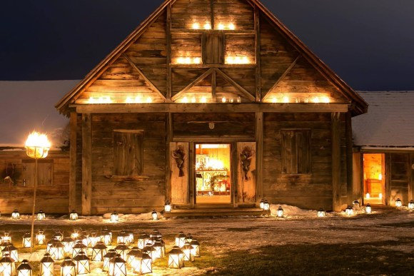 Heritage building lit up with lights and candles during First Light