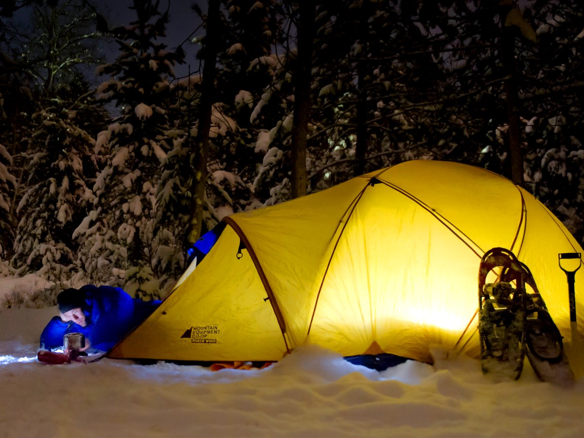 tent lit up in the snow