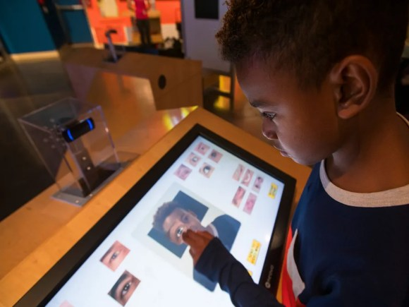 child at an interactive display