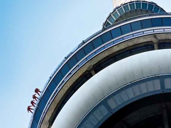 Four people take the exciting EdgeWalk of the CN Tower
