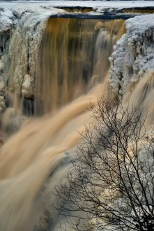 Rushing water over the ice.