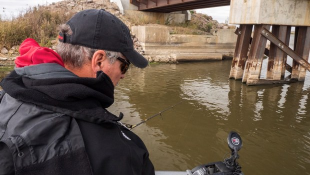 """Shortly after that, Gary noticed a fish next to a boulder, so he put his MotorGuide Xi5 bow mount trolling motor in """"anchor mode"""" and began working his blade bait vertically."""