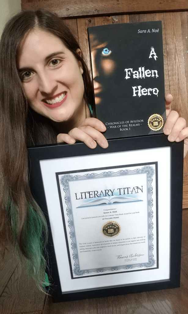Author Sara A. Noe with her novel A Fallen Hero and Literary Titan Gold Book Award