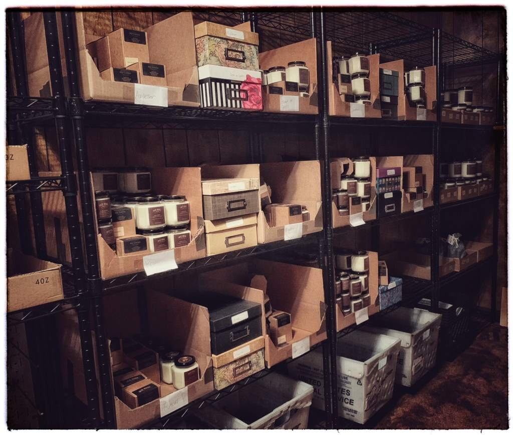 Old Soul Artisan stockroom with boxes of literary candles