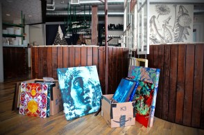 New art exhibit by Rich Ray being staged for hanging at duo Restaurant.
