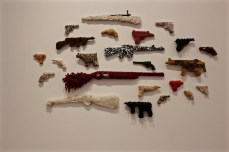 Jerilea Zempel's playful and sometimes silly take on guns, wrapped in various materials.