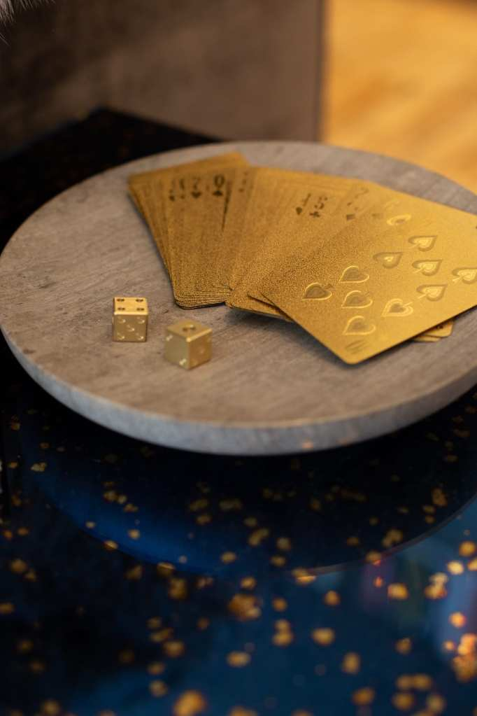Golden deck of cards and dice
