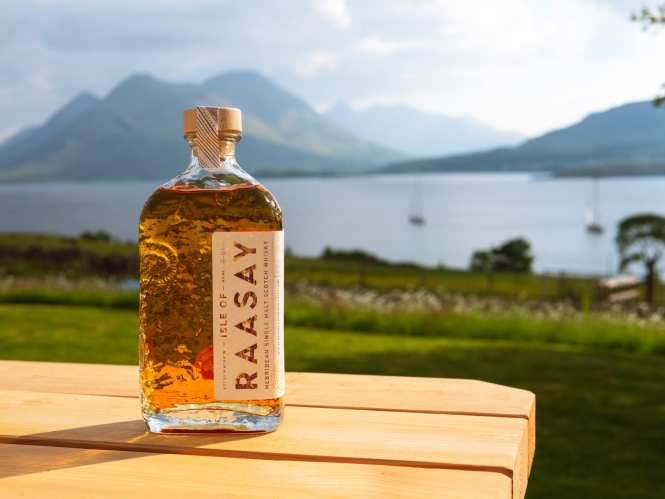 Isle of raasay whisky bottle with a view of skye