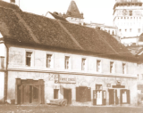 Old town - bad quality - part of the main square, the building you see still stands (as of 90% of the ones in the other pictures) - nowadays from left to right, each door, there is a: public bathroom; underwear shop; tax office; clothes shop.