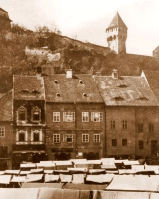 Old town - fair day. Main square, just a part of it. Buildings in front still stand. Nowadays private residence.