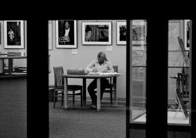 A female student studies in the Pattee Gallery