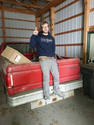 Joseph Marcus poses with his newly acquired Ford F150 pickup truck.