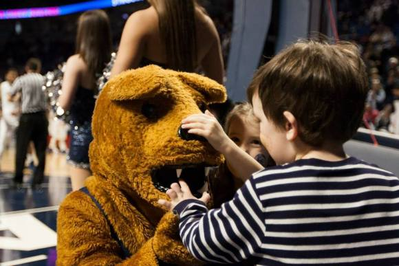 These THON kids had to make sure that they were hanging out with a real, living Nittany Lion. (Photo by: Bobby Chen)