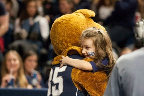 Brooke, a THON sibling, snuggles with the Nittany Lion. (Photo by: Bobby Chen)