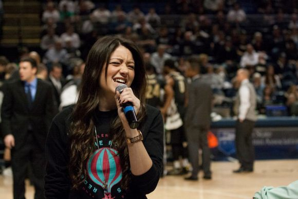 "The composers of ""Diamonds in the Air,"" Brittany Hicks and Chris Carmody, performed their original song about THON during an early timeout at the basketball game."