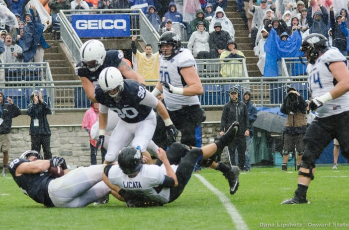 Anthony Zettel bats down a Bulls pass straight into the arms of Carl Nassib for an interception during the second  quarter.