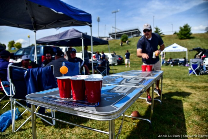 Penn State tailgaters play a round of beer pong before the game on Saturday.