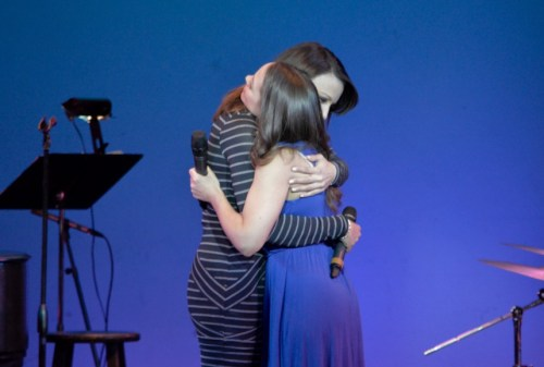 "Caroline Bowman and Laurie Veldheer embrace after singing ""Some Things Are Meant To Be."" ""Some Things Are Meant To Be"" is a favorite song of the actresses."