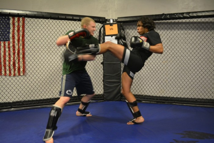 Adam Cole and Khaled Sabah sparring.