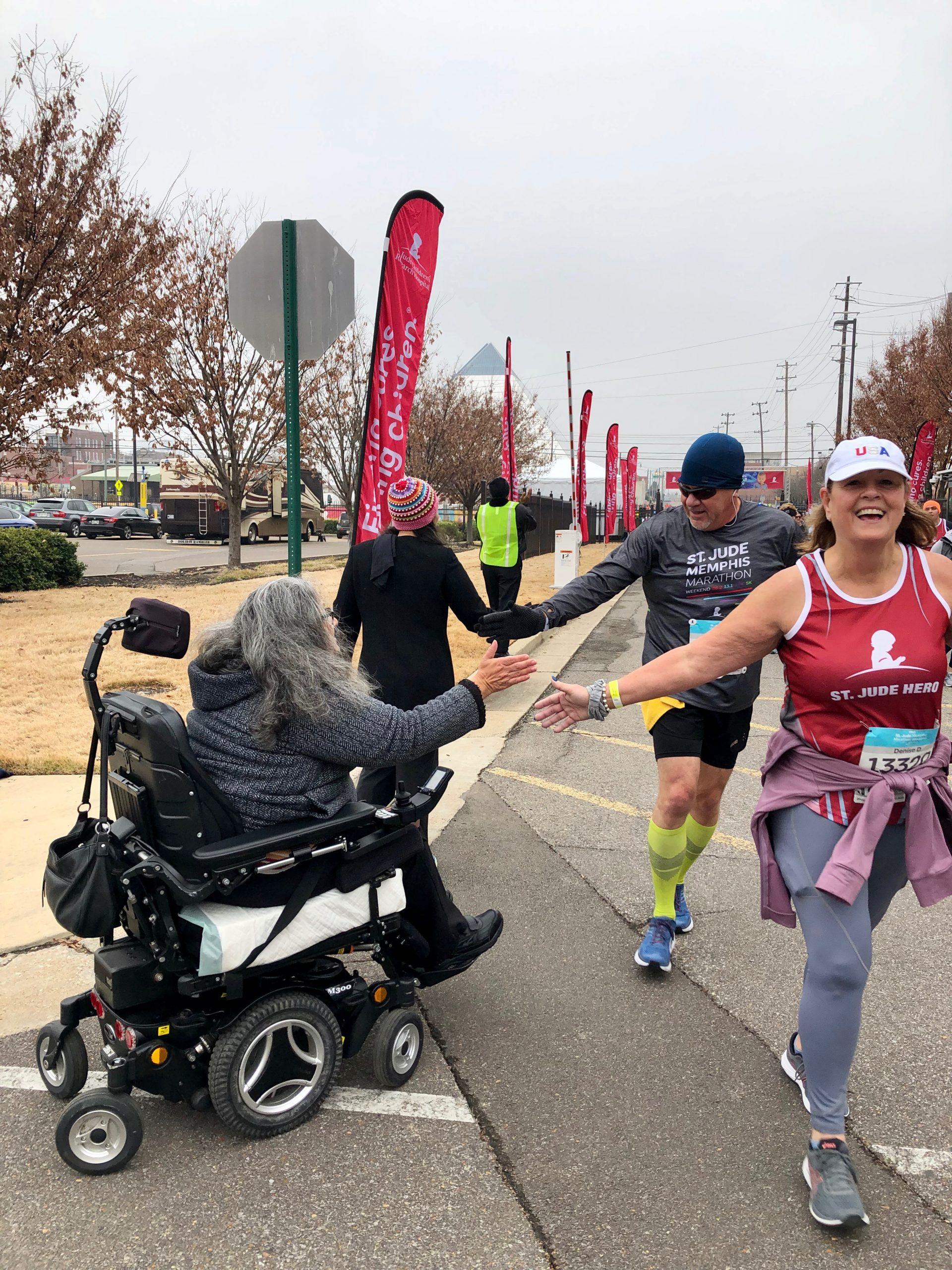 Meet Gabby Salinas: high-fiving at the St. Jude Marathon