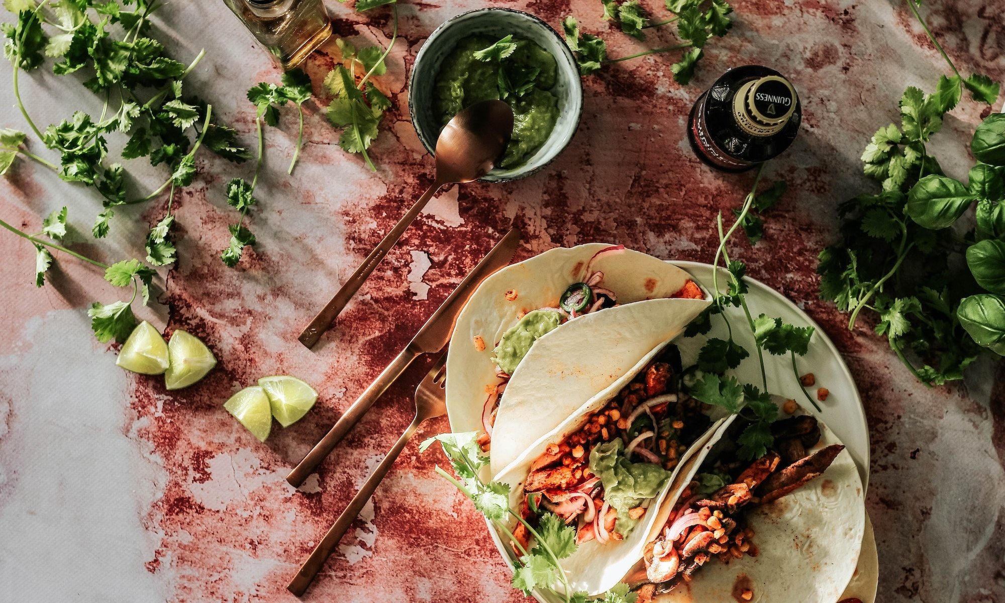 tacos and guacamole on a table