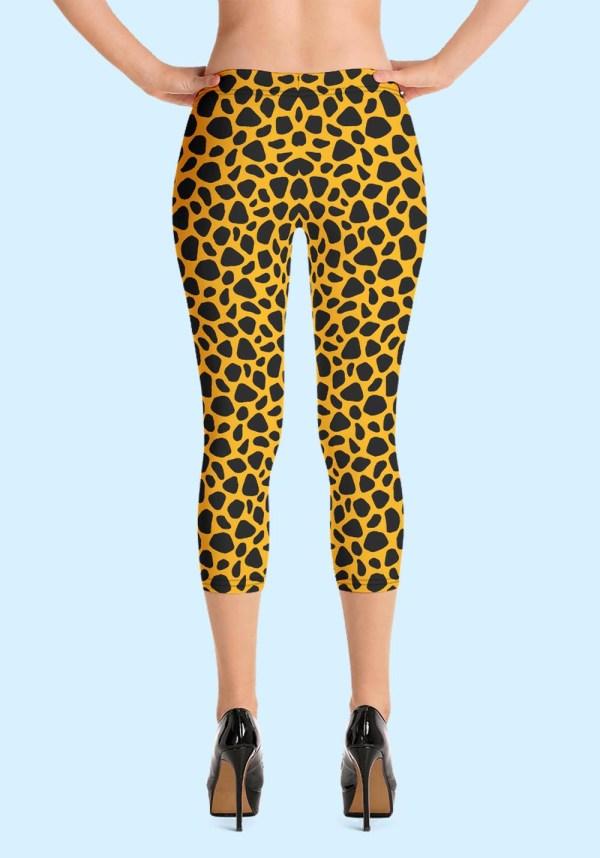 Woman wearing unique Leopard Zouk Capri Leggings designed by Ooh La La Zouk. Back high heels view.