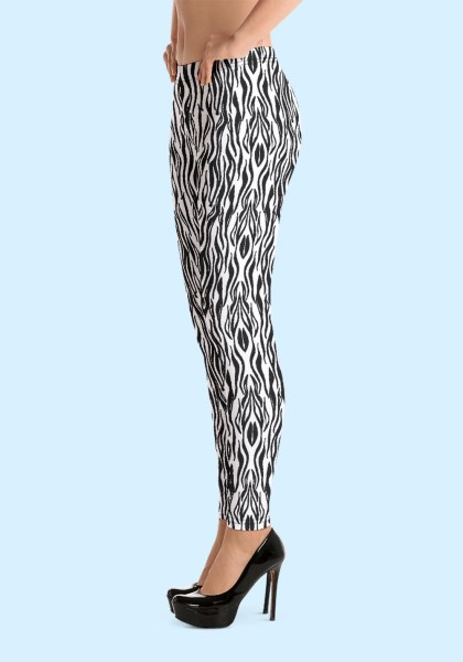 """Woman wearing Zouk Leggings decorated with a unique """"Animalistic Zouk"""" design by Ooh La La Zouk. Left side view (3) in high heels."""