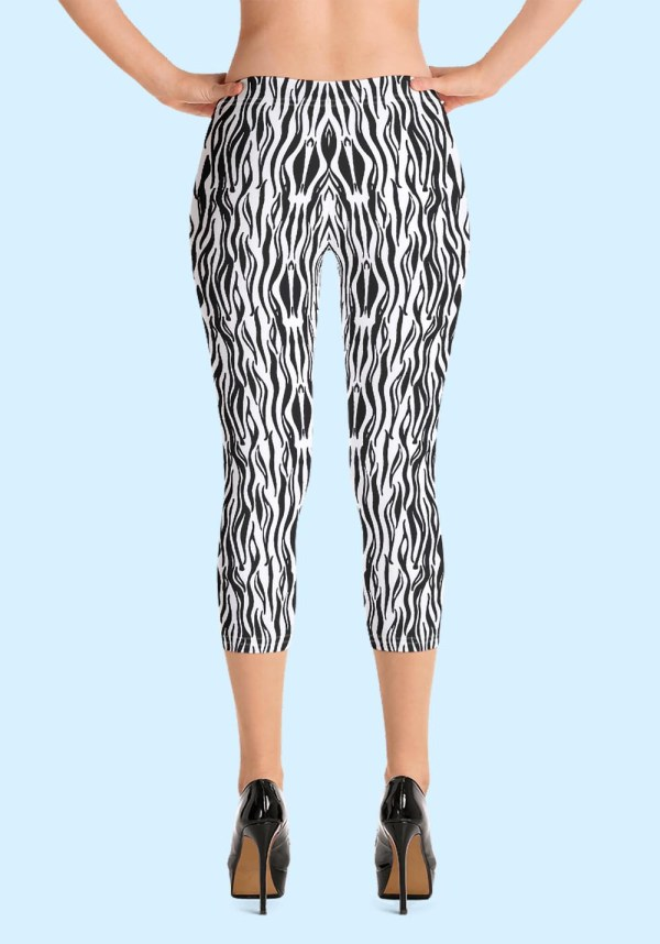 "Woman wearing Zouk Capri Leggings decorated with a unique ""Animalistic Zouk"" design by Ooh La La Zouk. Back view (3) high heels."