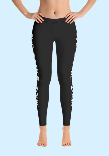 """Woman wearing Zouk Leggings decorated with a unique """"Love Dance Zouk"""" design. Front view (1). By Ooh La La Zouk."""