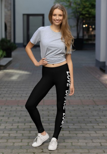 "Woman wearing Zouk Leggings decorated with a unique ""Love Dance Zouk"" design by Ooh La La Zouk. Lifestyle view in sneakers."