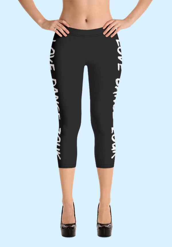 """Woman wearing Capri Zouk Leggings decorated with a unique """"Love Dance Zouk"""" design. Front view (3) high heels. By Ooh La La Zouk."""