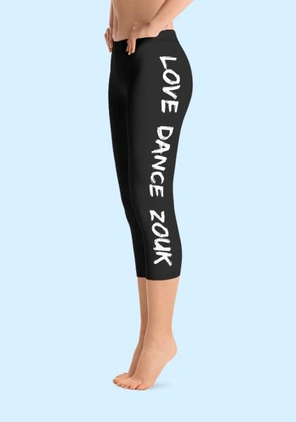 """Woman wearing Capri Zouk Leggings decorated with a unique """"Love Dance Zouk"""" design. Left side view (1) barefoot. By Ooh La La Zouk."""