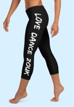 """Woman wearing Capri Zouk Leggings decorated with a unique """"Love Dance Zouk"""" design. Left side view (2) barefoot. By Ooh La La Zouk."""