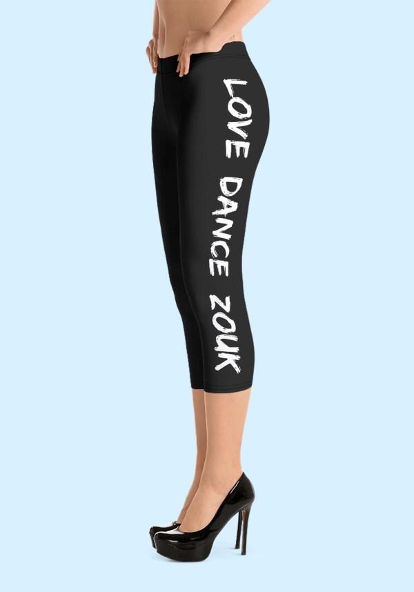"""Woman wearing Capri Zouk Leggings decorated with a unique """"Love Dance Zouk"""" design. Left side view (3) high heels. By Ooh La La Zouk."""