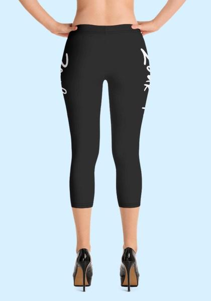 """Woman wearing Capri Zouk Leggings decorated with a unique """"Zouk me"""" design. Back view (3) high heels. By Ooh La La Zouk."""
