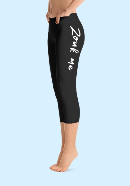 "Woman wearing Capri Zouk Leggings decorated with a unique ""Zouk me"" design. Left side view (1) barefoot. By Ooh La La Zouk."
