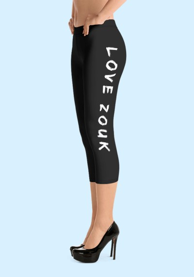 "Woman wearing Zouk Leggings decorated with unique ""Love Zouk"" Capri design by Ooh La La Zouk. Left side, high heels view."