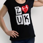 """Woman wearing Zouk T-shirt decorated with """"deeply connected Zouk Dancers in a unique heart design (black, crew neck style)"""