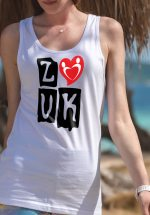 "Woman wearing Zouk T-shirt decorated with ""deeply connected Zouk Dancers in a unique heart design (white, tank top style) close-up"