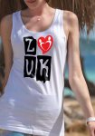 """Woman wearing Zouk T-shirt decorated with """"deeply connected Zouk Dancers in a unique heart design (white, tank top style) close-up"""