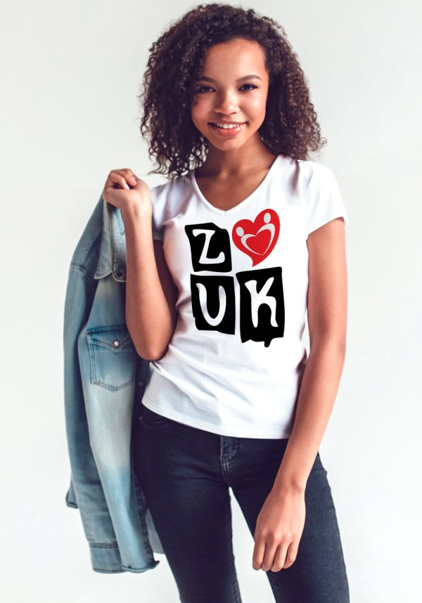 "Woman wearing Zouk T-shirt decorated with ""deeply connected Zouk Dancers in a unique heart design (white, v-neck style)"
