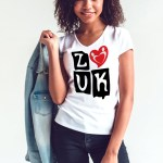 """Woman wearing Zouk T-shirt decorated with """"deeply connected Zouk Dancers in a unique heart design (white, v-neck style)"""