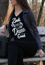 "Woman wearing Zouk T-shirt decorated with unique ""Zouk feels so damn good"" design (black v-neck style)"