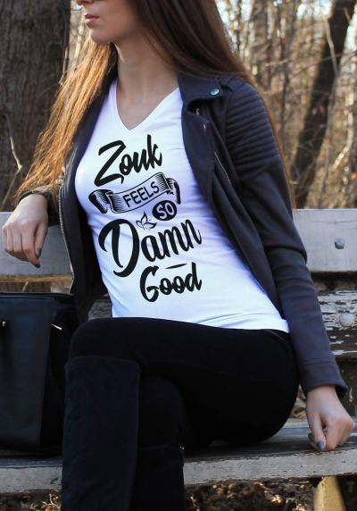 "Woman wearing Zouk T-shirt decorated with unique ""Zouk feels so damn good"" design (white v-neck style)"
